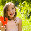 Girl and a lollipop — Stock Photo #78445318