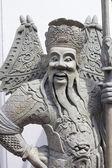 Chinese stone statue in Wat Pho, Bangkok, Thailand — Stock Photo