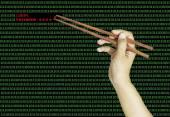 Hand using chopsticks to pinch the last password on binary compu — Foto de Stock