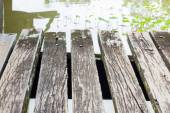 Grunge wood floor texture on the river — Stock Photo