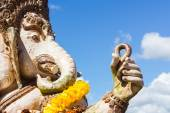 Close-up statute of Ganesha outdoor against blue sky and white c — Stock Photo
