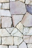 Multi-colored and multi-sized, pale rocks wall grunge texture ba — Photo