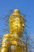 Buddha image reparation on the blue sky — Stock Photo