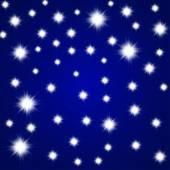 Glittering stars on blue background. Vector illustration. Eps 10 — Stock Vector