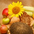Autumn harvest of fruits and vegetables piled on the table. — Stock Photo #56572731