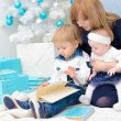 Mommy with children at New Year tree — Stock Photo #52497269