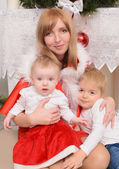 Family in Christmas clothes — Stock Photo