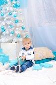 Boy in New Year interior — Stock Photo