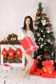 Young brunette woman in christmas interior — ストック写真