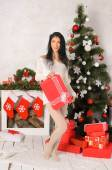 Young brunette woman in christmas interior — Fotografia Stock