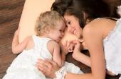 Mother and daughter on pillow — Photo