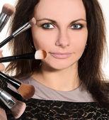 Female visagiste with brushes — Stok fotoğraf