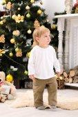 Toddler boy in christmas interior — Stock Photo