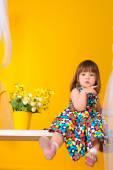 little girl sitting on the Swings — Stock Photo