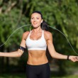 Sport, activity. Cute woman with skipping rope — Stock Photo #56647331