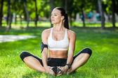 Yoga woman on green grass in lotus pose — Stock Photo