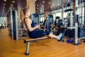 Sport, fitness, lifestyle and people concept - young woman flexi — Zdjęcie stockowe