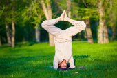 Practicing yoga in the morning, with trees  background — Foto Stock