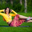 Exercising fitness woman sit ups outside during crossfit exercise training. Happy fit girl doing side crunches with elevated legs while smiling happy. — Stock Photo #72525243