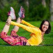 Pretty woman doing yoga exercises in the park — Stock Photo #72525285