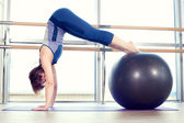 Young girl working out at the gym with a ball. — Stock Photo