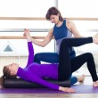 Aerobics Pilates personal trainer helping women group in a gym class — Stock Photo #72781779