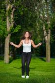 Sport, activity. Cute woman with skipping rope — Stock Photo