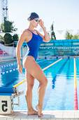 Portrait of a female swimmer, that wearing  swimming cap and go — Stock Photo