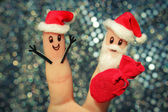 Face painted on fingers. Santa Claus gives gifts. Toned image — Stock Photo
