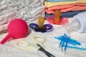 Nipple, bottle, scissors, diapers, clothes, enema, cotton swab — Stock Photo
