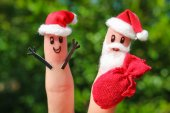 Face painted on the fingers. Santa Claus for Christmas — Stock Photo