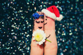Finger art of a Happy couple. Man is giving flowers to a woman. Toned image. — Stock Photo