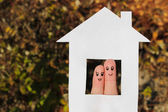 Finger art of a Happy couple. Family looking out of the window of the house out of paper. — Stock Photo
