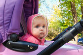 Small child sits in the stroller — Stock Photo