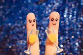 Finger art of a Happy couple. Couple making good cheer. Two glasses of champagne. Toned image. — Stock Photo