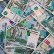 Thousands of Russian roubles banknotes — Stock Photo #62547915