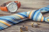 Tie, cufflinks and watches on the old wood background — Stock Photo