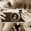 Girl taking photographs with vintage camera.. Black and white shot. — Stock Photo #65864709