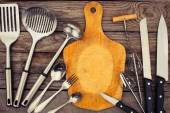Kitchen utensils on wooden background. Toned image. — Stock Photo