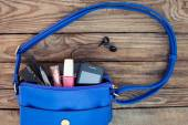 Blue women's purse. Things from open lady handbag — Stock Photo
