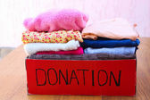 Donation box with clothes — Stock Photo