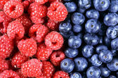 Close up Fresh Organic  Blueberries and Raspberries. Rich with vitamins Background, texture — Stock Photo