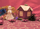 Little toy house and angel figurine — Стоковое фото