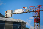 Red and white construction crane — Stock Photo