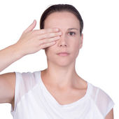 Woman with hand over one eye — Stock Photo