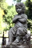 Old statue on grave in the Lychakivskyj cemetery of Lviv, Ukraine. — Stockfoto