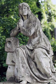 Old statue on grave in the Lychakivskyj cemetery of Lviv, Ukrain — Stock Photo