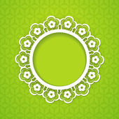 Floral frame on the green background — Stock Vector