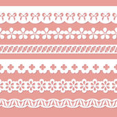 Set of seamless paper laces on the pink background — Vecteur