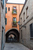 Ancient medieval street in the downtown of Ferrara city — Stock Photo